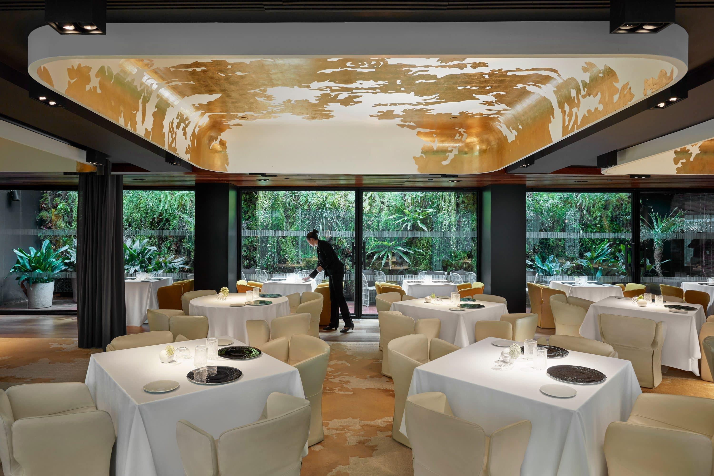 Tables being set up for service inside Moments restaurant at Mandarin Oriental, Barcelona