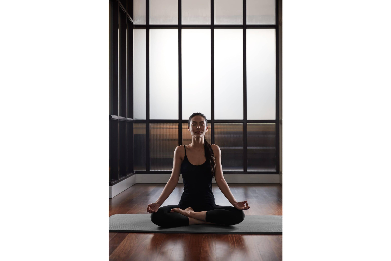 Woman practises yoga