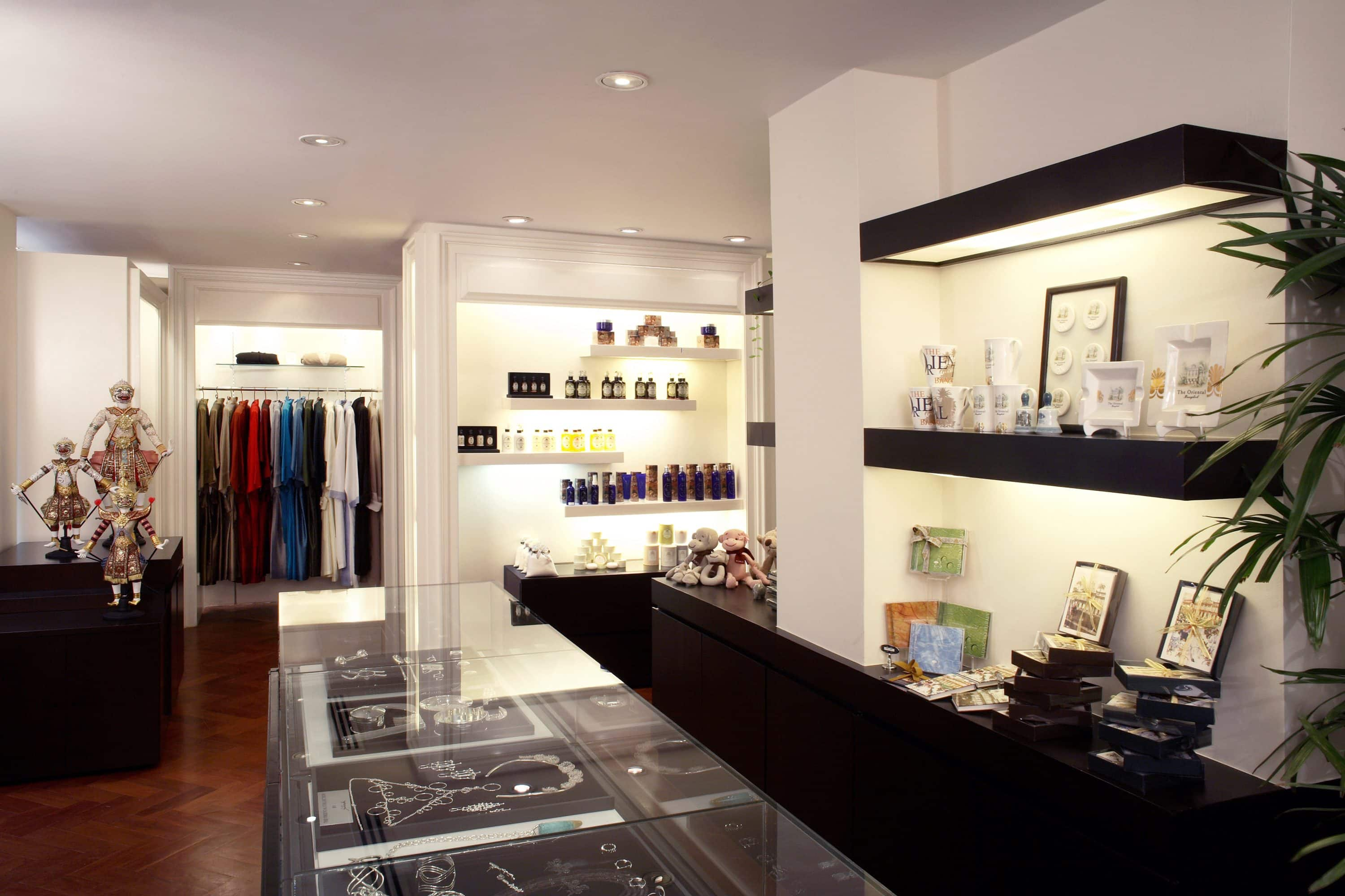 Trays of silver jewellery and objets displayed on shelves inside a lifestyle shop in Bangkok