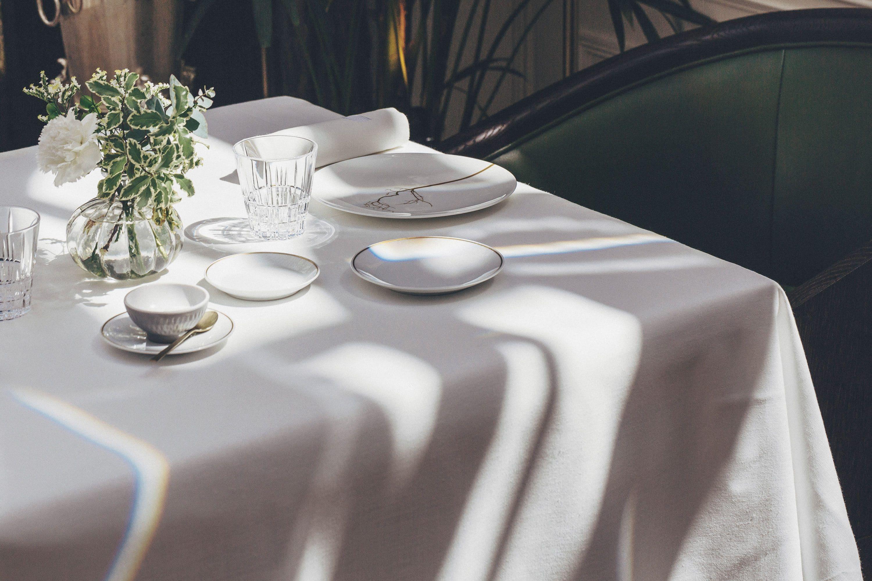 Afternoon tea laid on white table cloth
