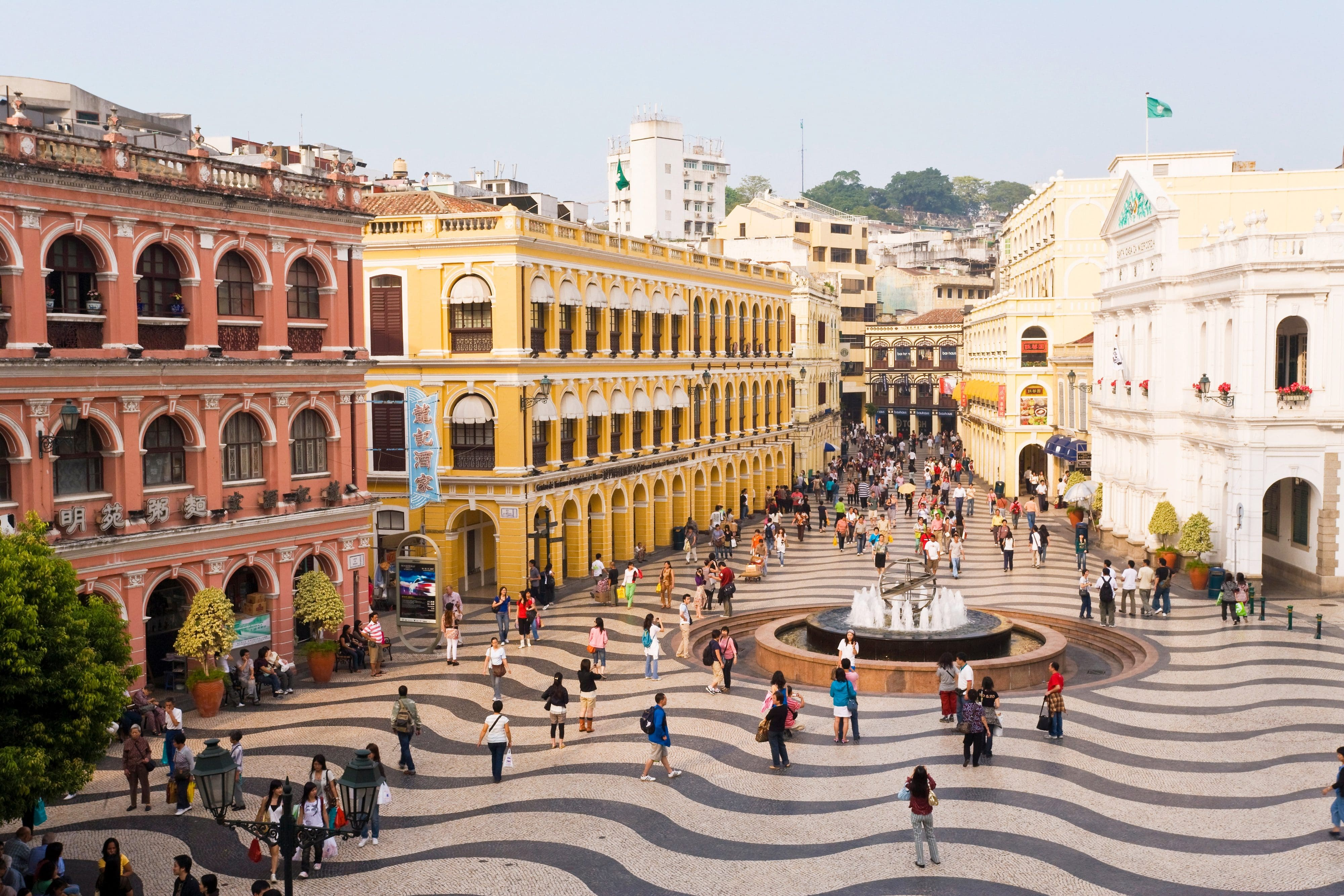 View of Senado Square in Macau with its tiled pavement and colourful buildings