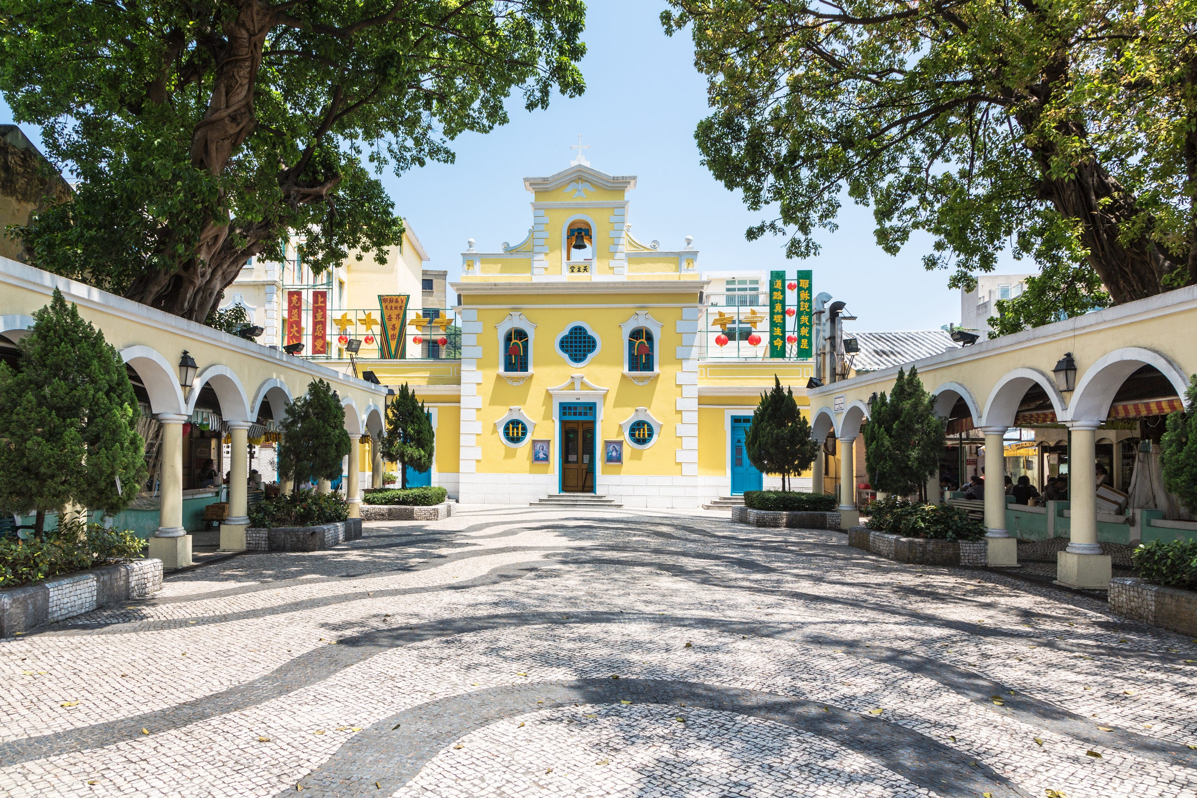 Church square in Coloane with its bright yellow and white church