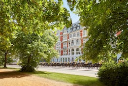 Exterior of Mandarin Oriental Hyde Park, London with horseguards marching past