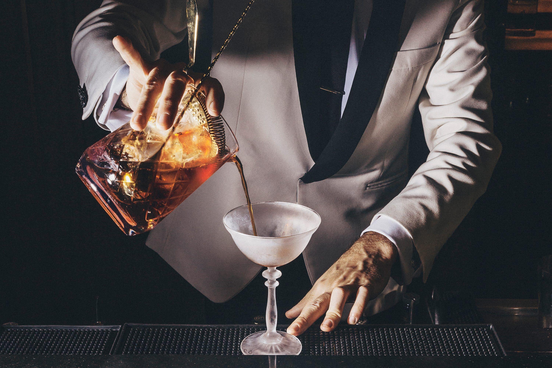 Mixologist serving a cocktail