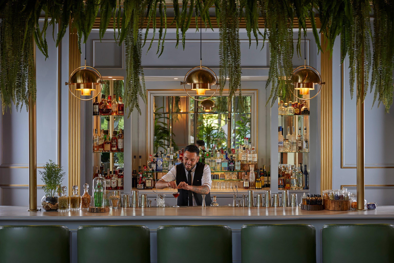 Bartender pours cocktail at Origen at Mandarin Oriental, Santiago