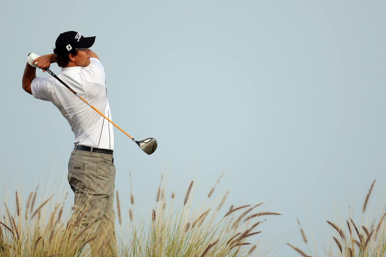 Adam Scott takes a swing at a golf course
