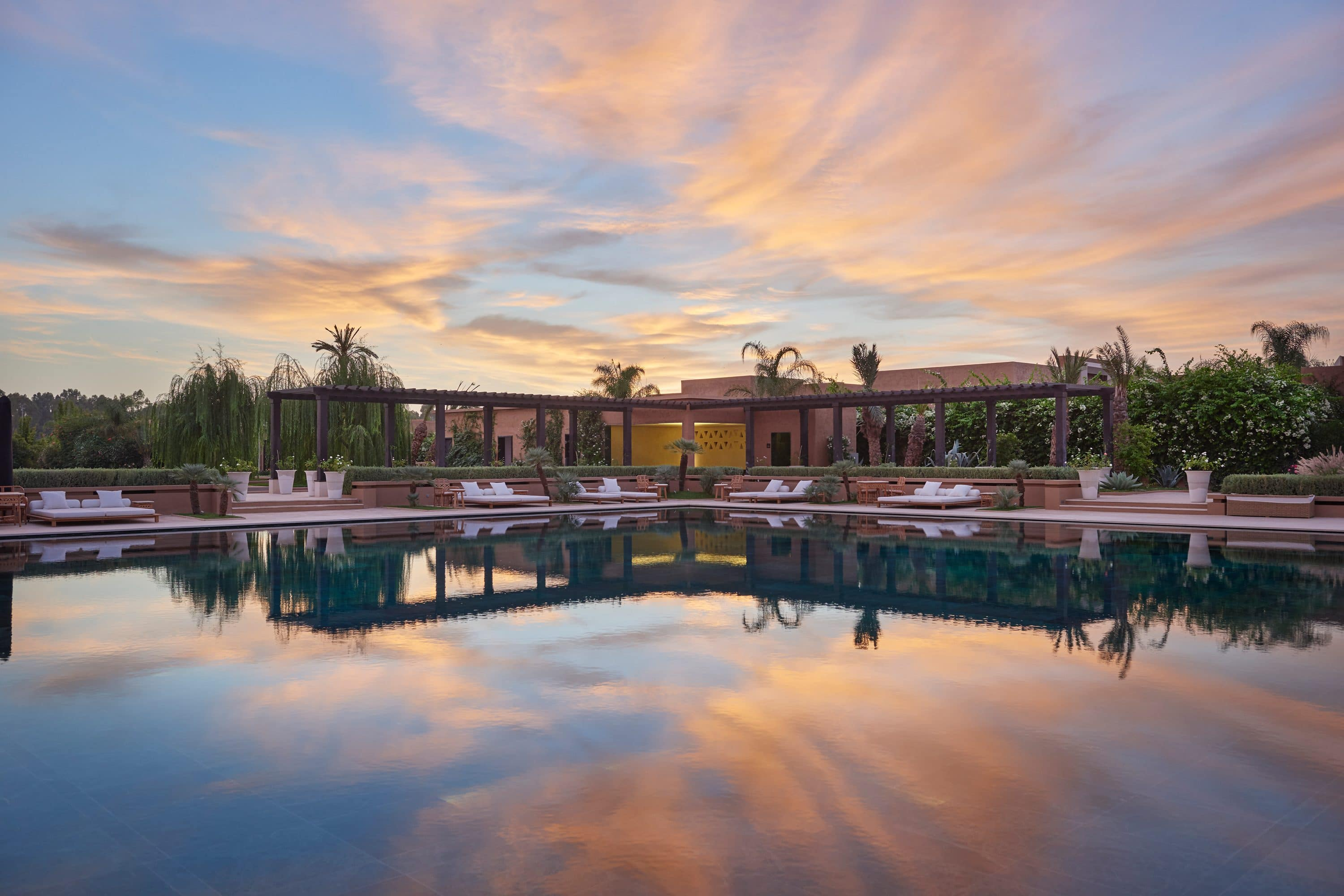 Pool and resort view at sunset at Mandarin Oriental, Marrakech