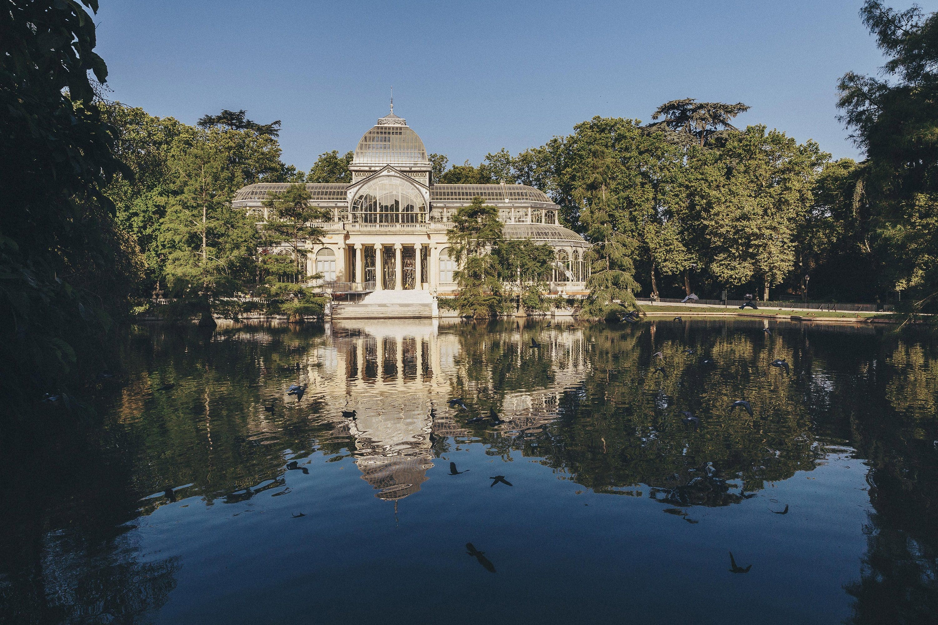 Palacio de Cristal with lake in foreground, Madrid