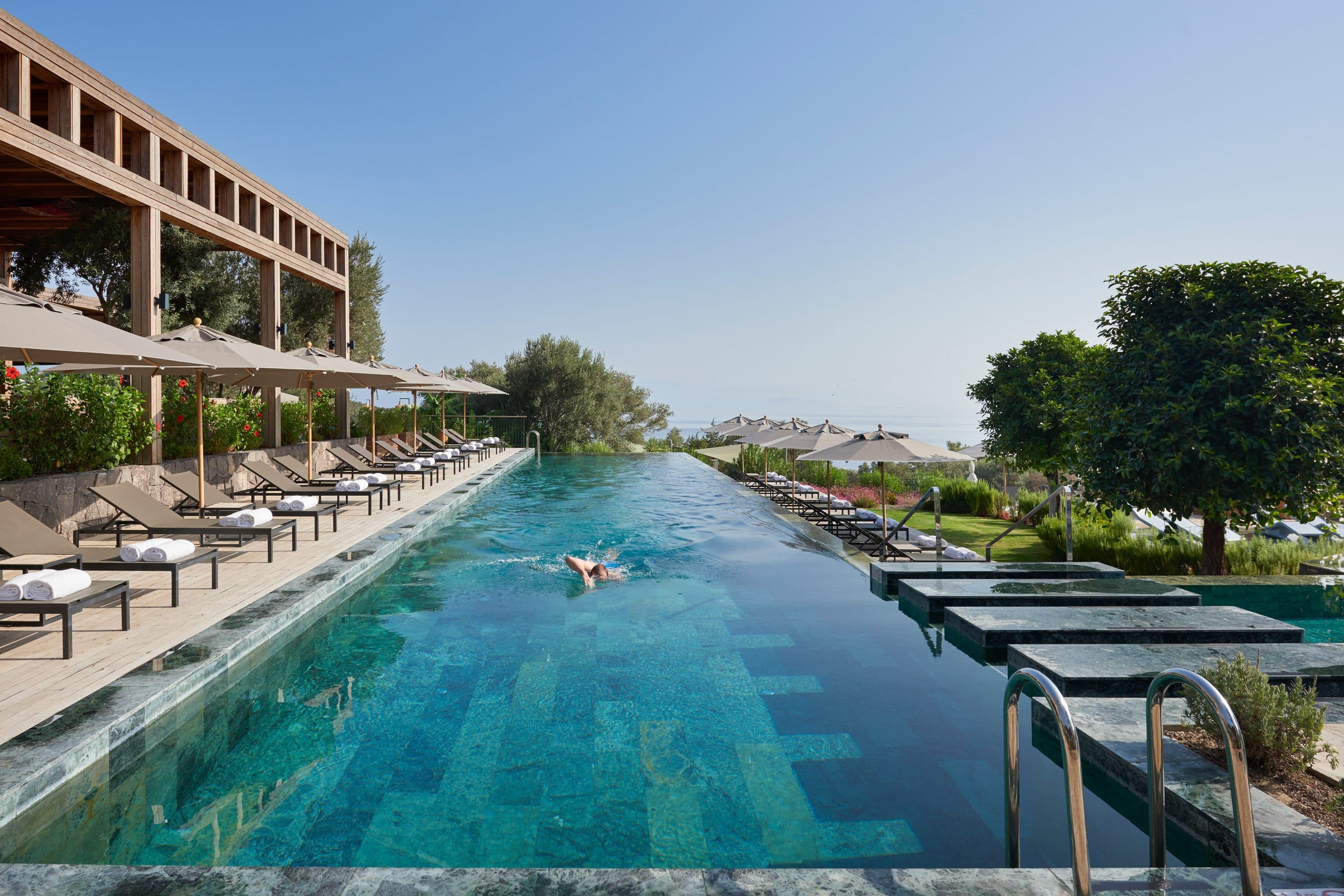 Man swims in pool in Bodrum