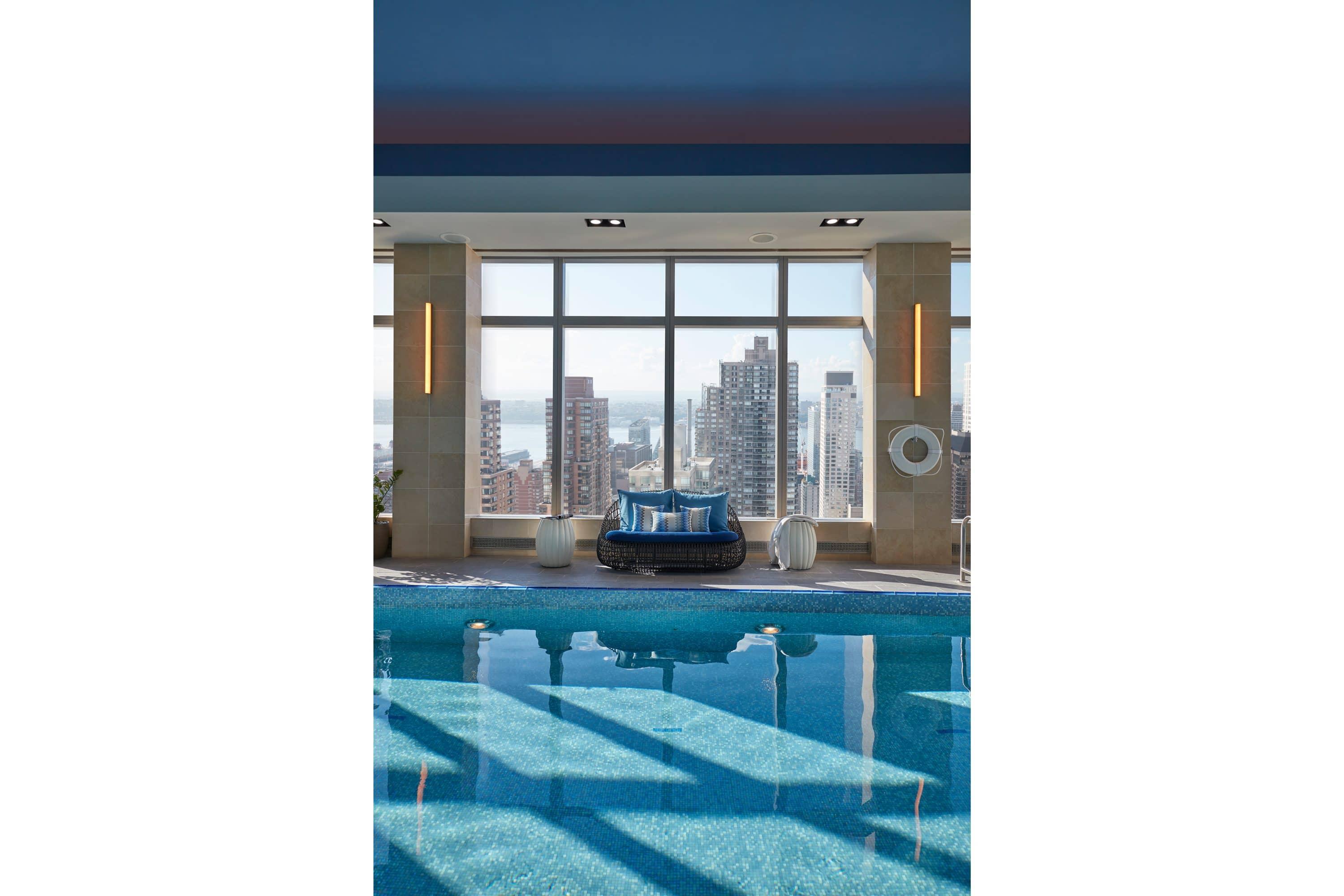 Indoor pool with view of New York