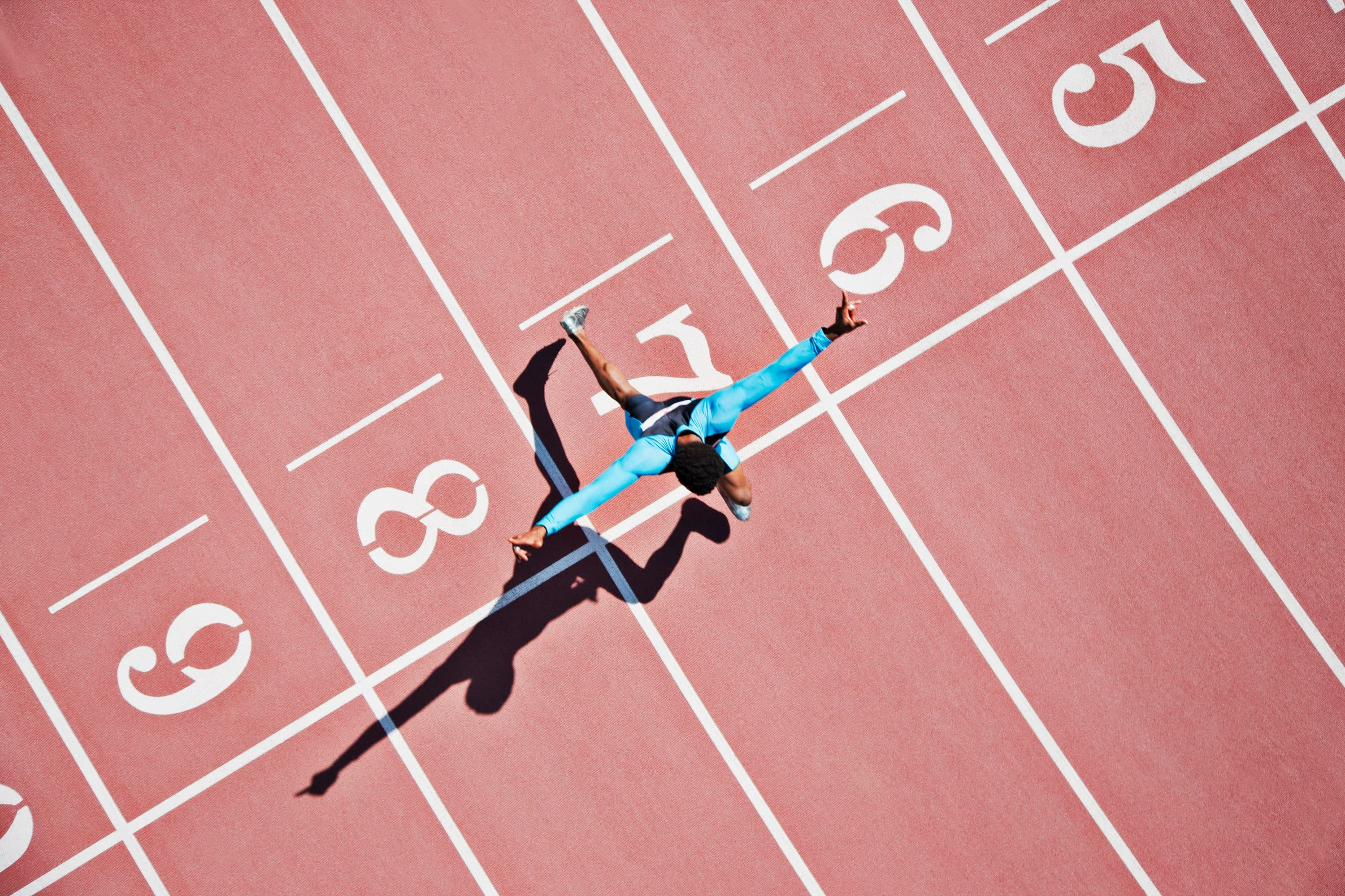 Person crossing the finishing line on a running track