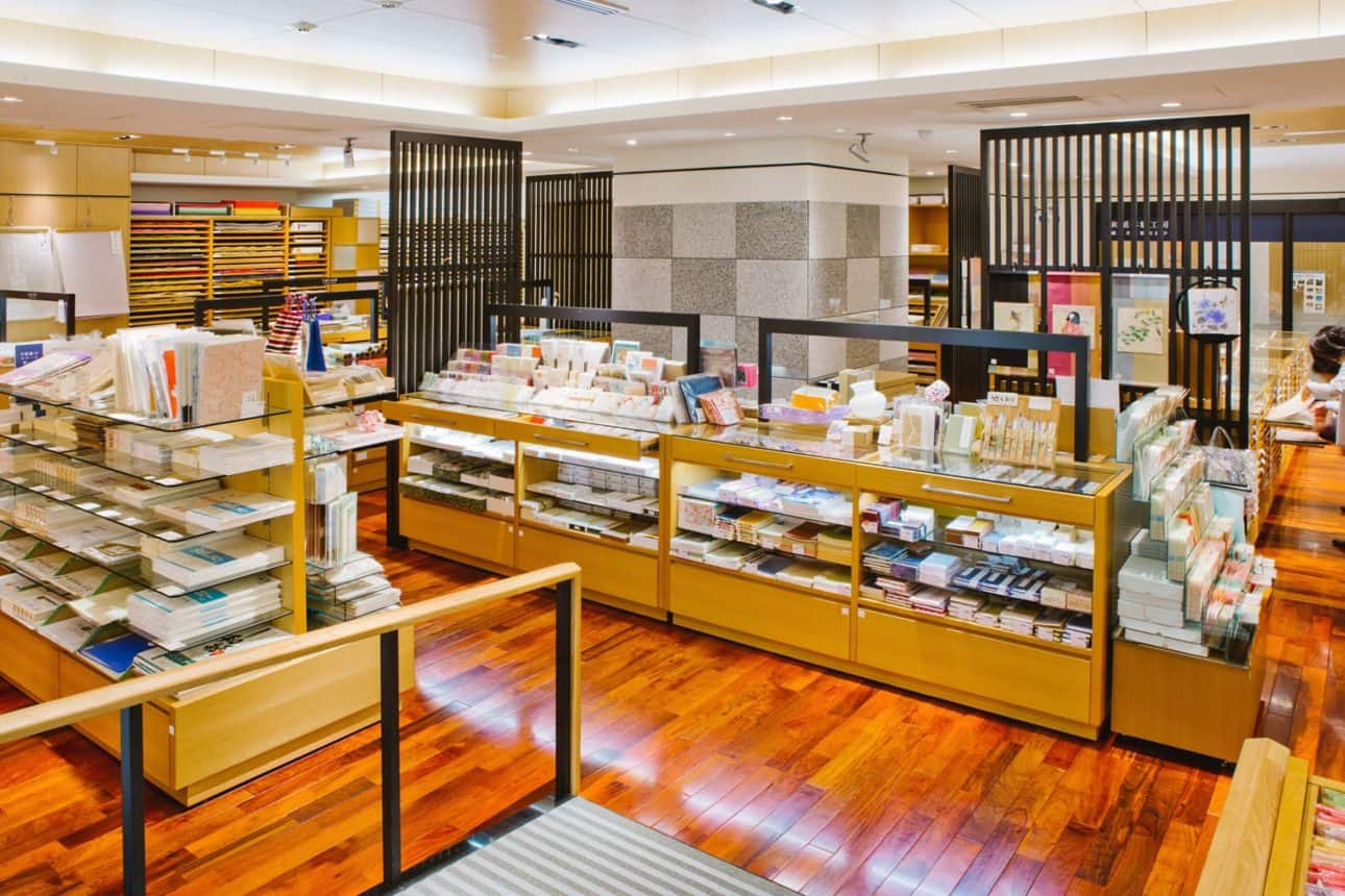 The interior of the paper shop and museum, Ozu Washi, complete with fully stocked glass cases, shelves and cabinets