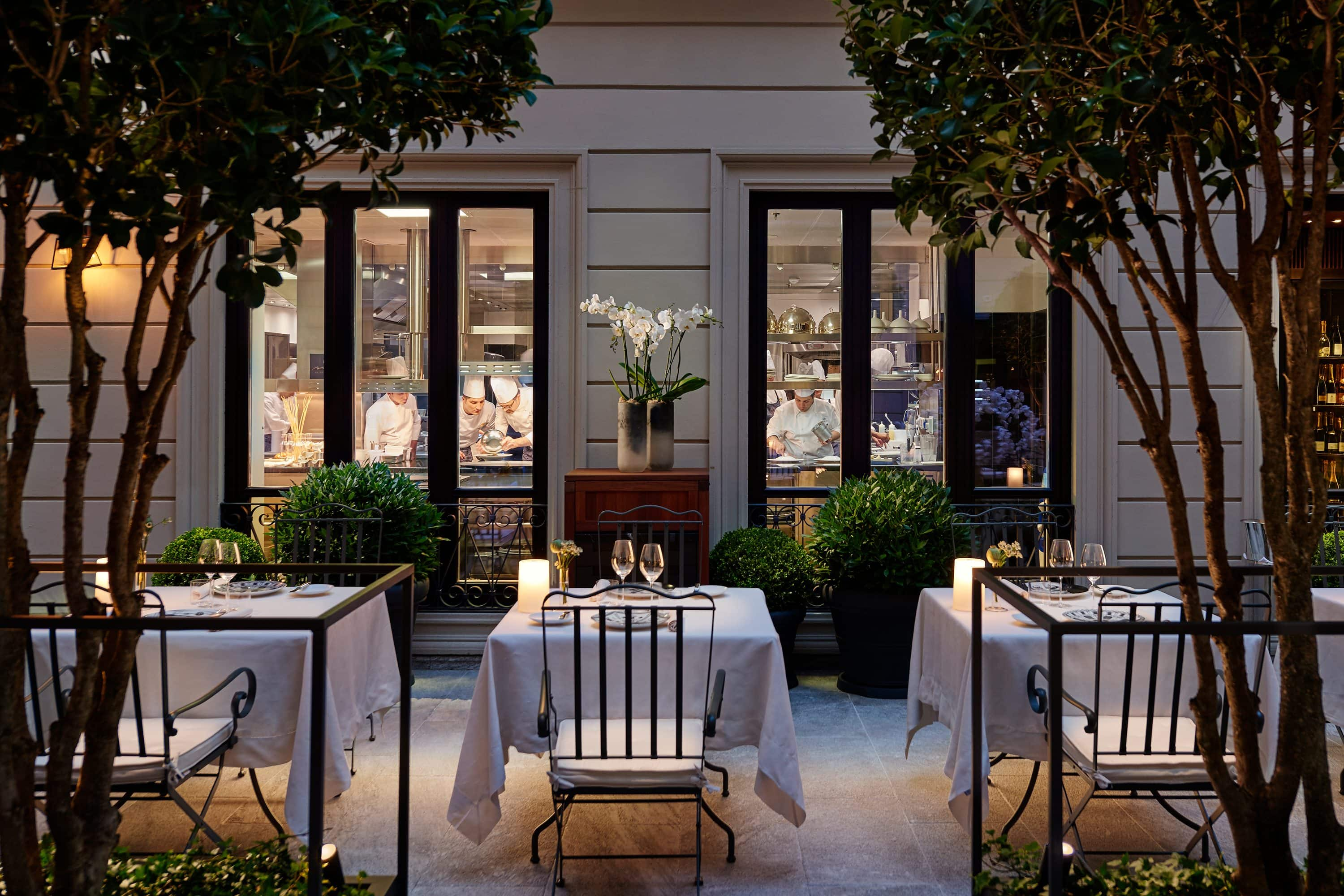 Courtyard with laid tables at Seta restaurant, Milan