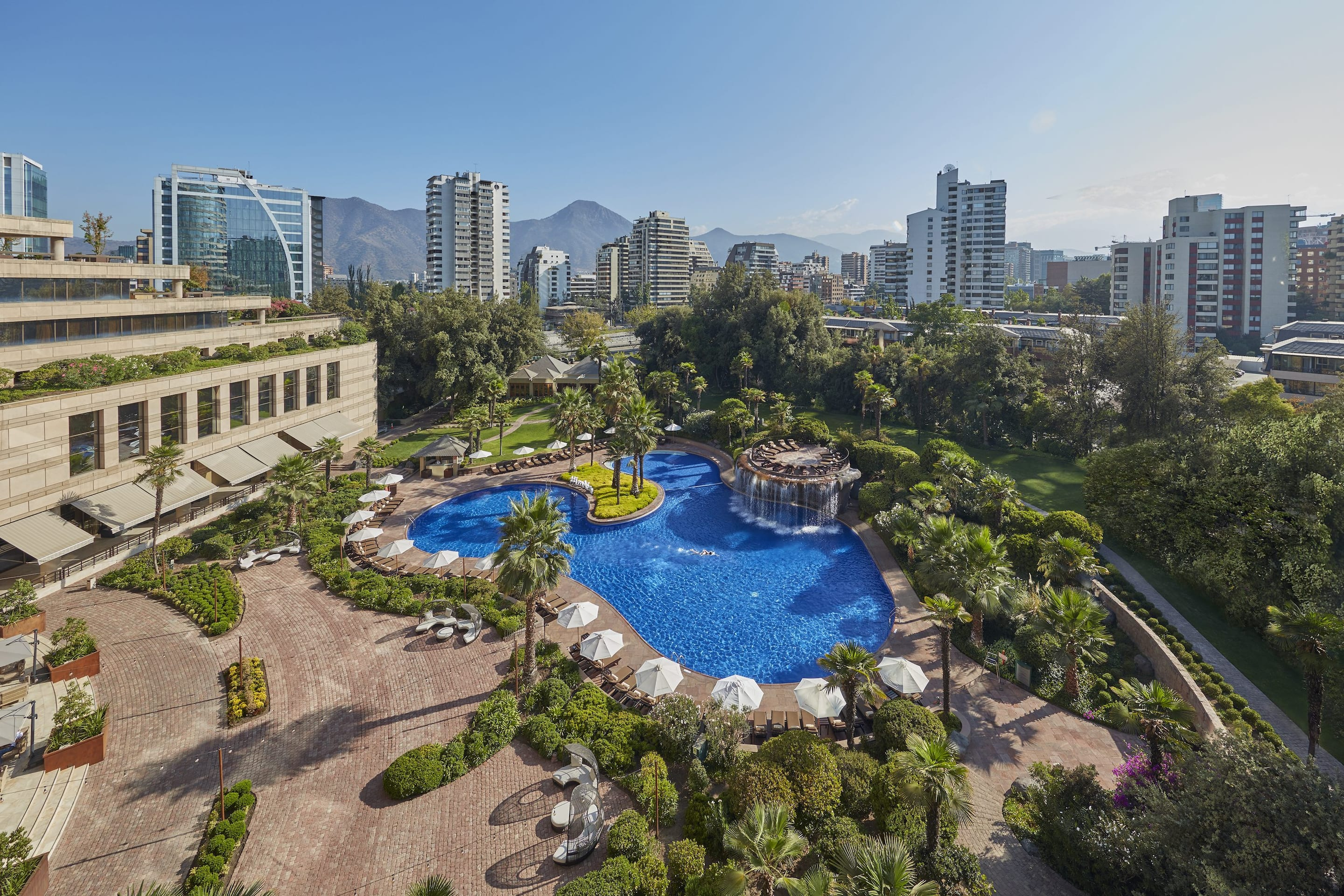 Outdoor pool and aerial view of Santiago with the skyline in the background