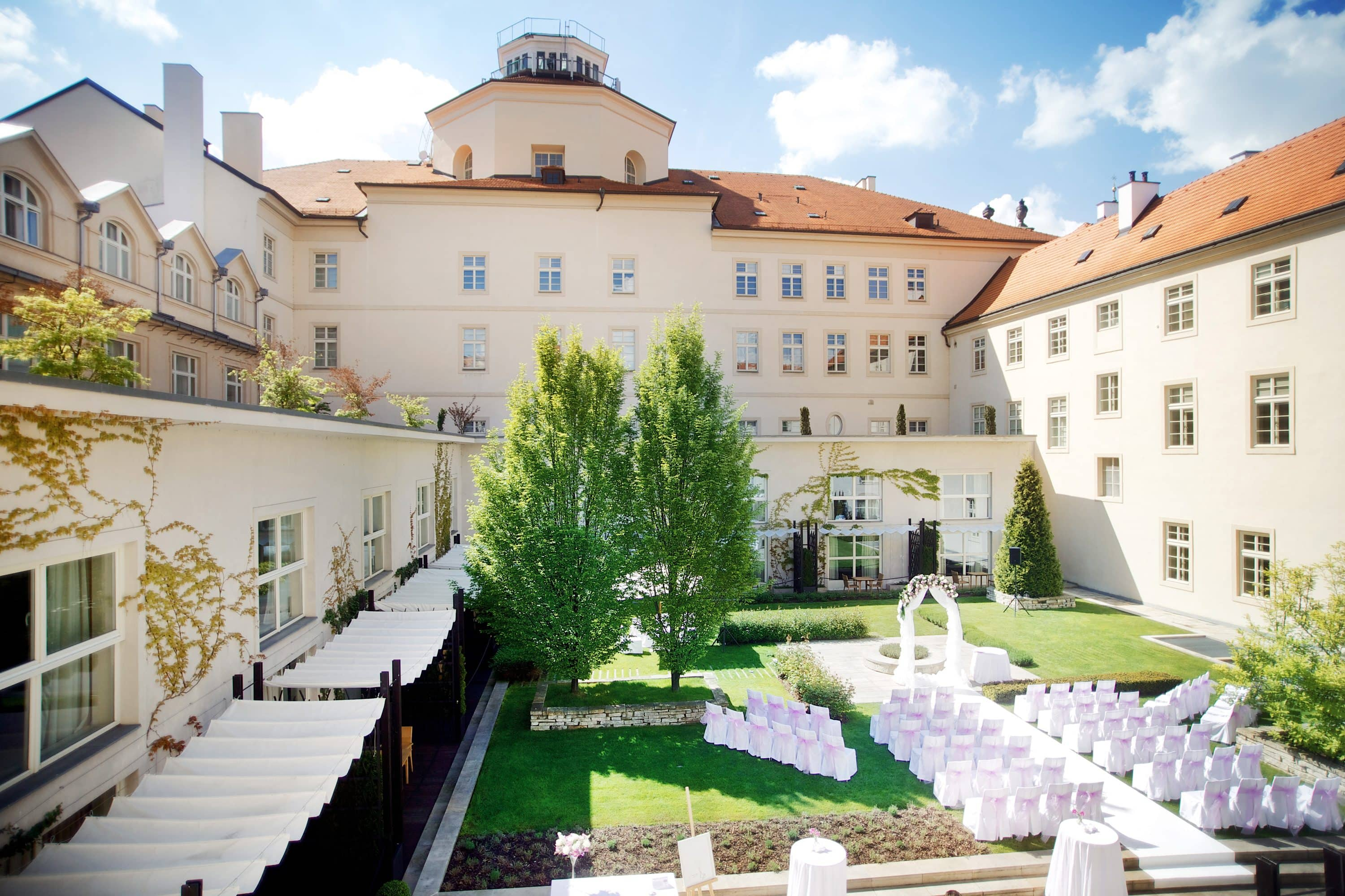 Covered seats set out in courtyard for a wedding at Mandarin Oriental, Prague
