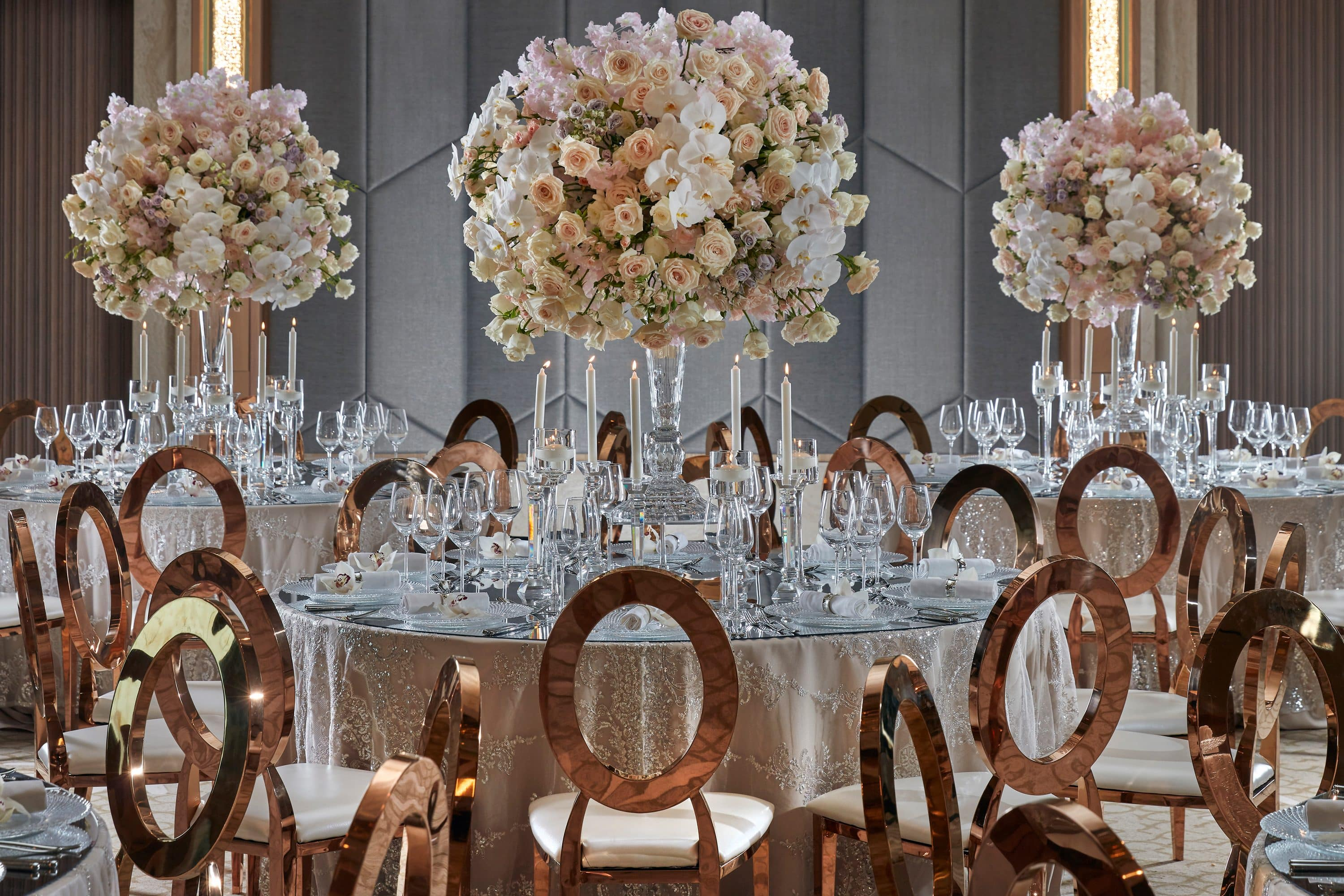 Tables lavishly dressed for a wedding reception