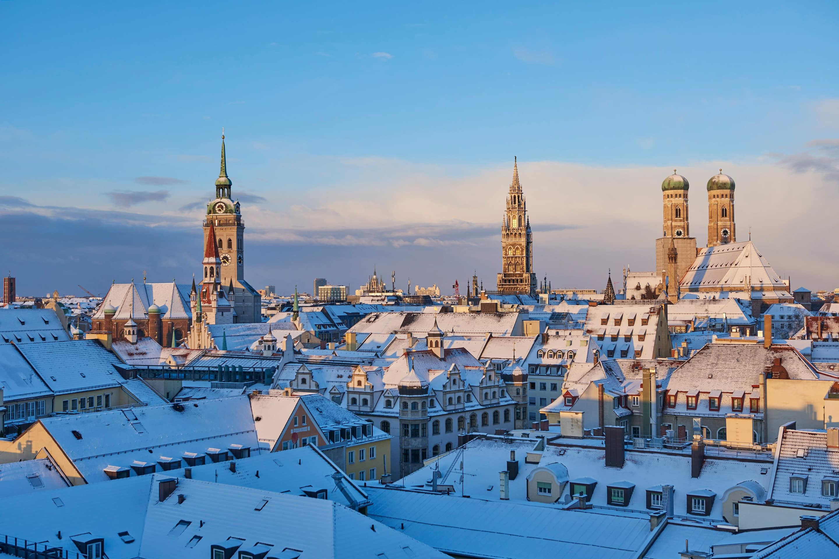 View of snow on rooftops over Munich