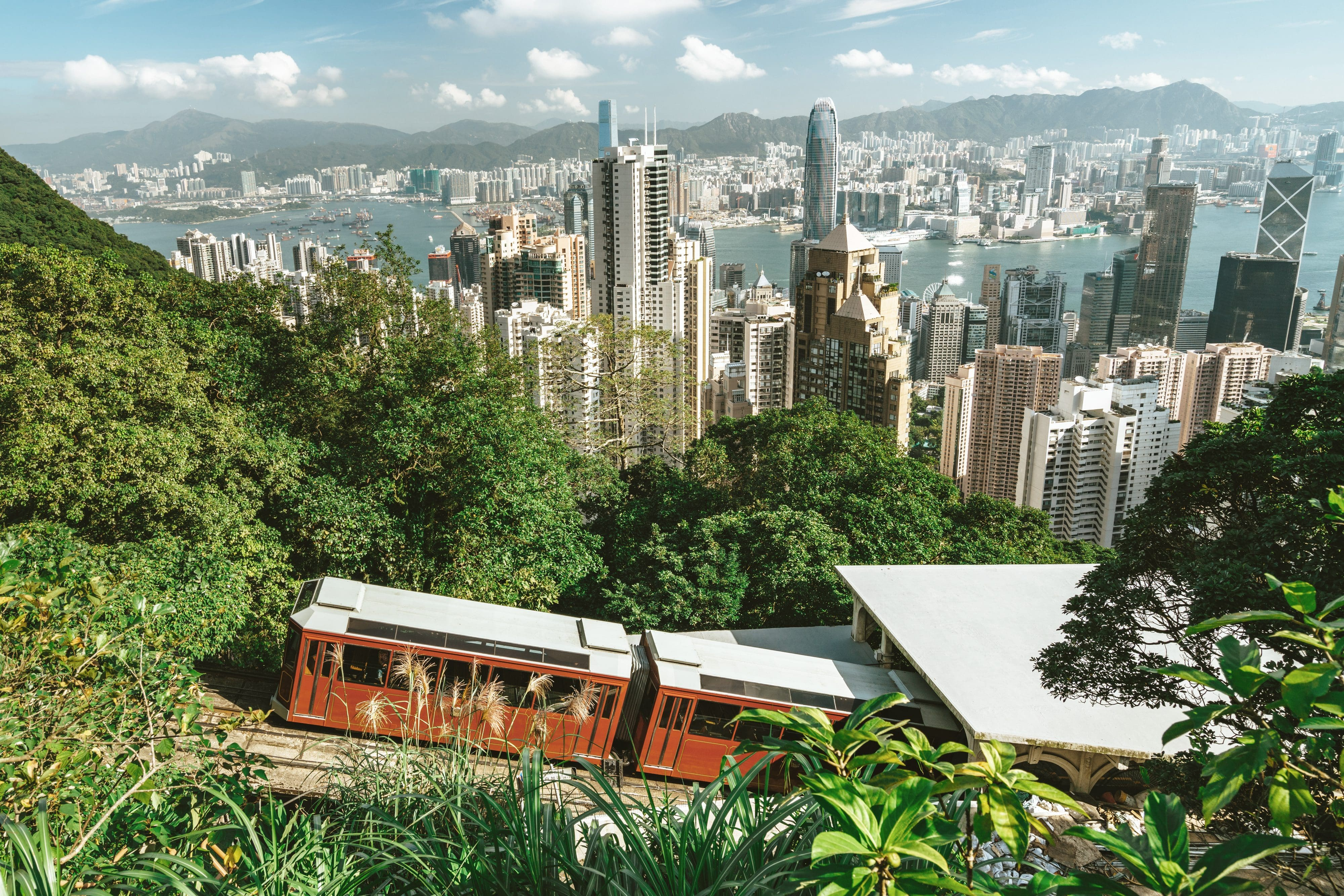 View from the top of Hong Kong's Victoria Peak overlooking the famous tram, the city skyline and Victoria Bay below