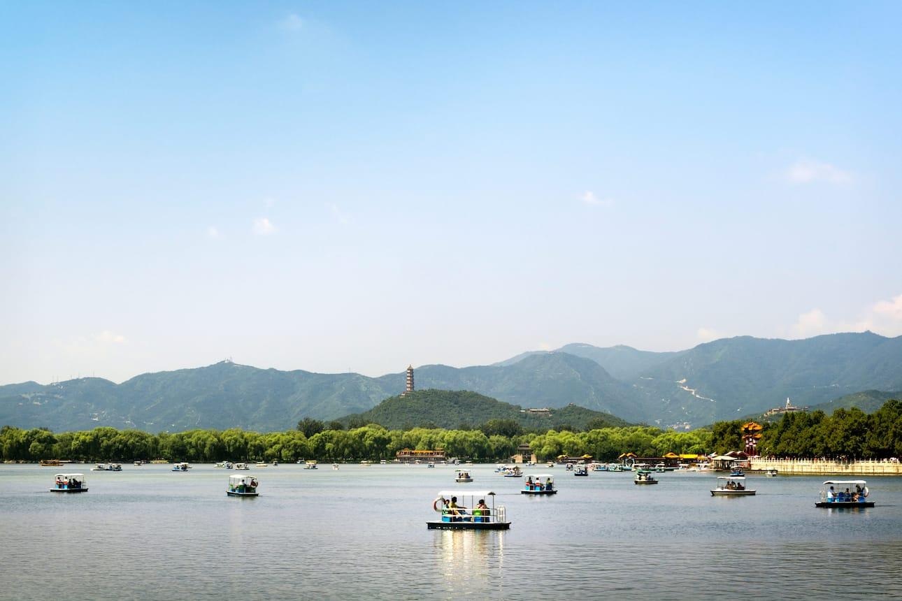 Visitors boating on the Behai Park lake