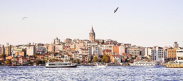 Galata tower in Istanbul and neighbourhood from water