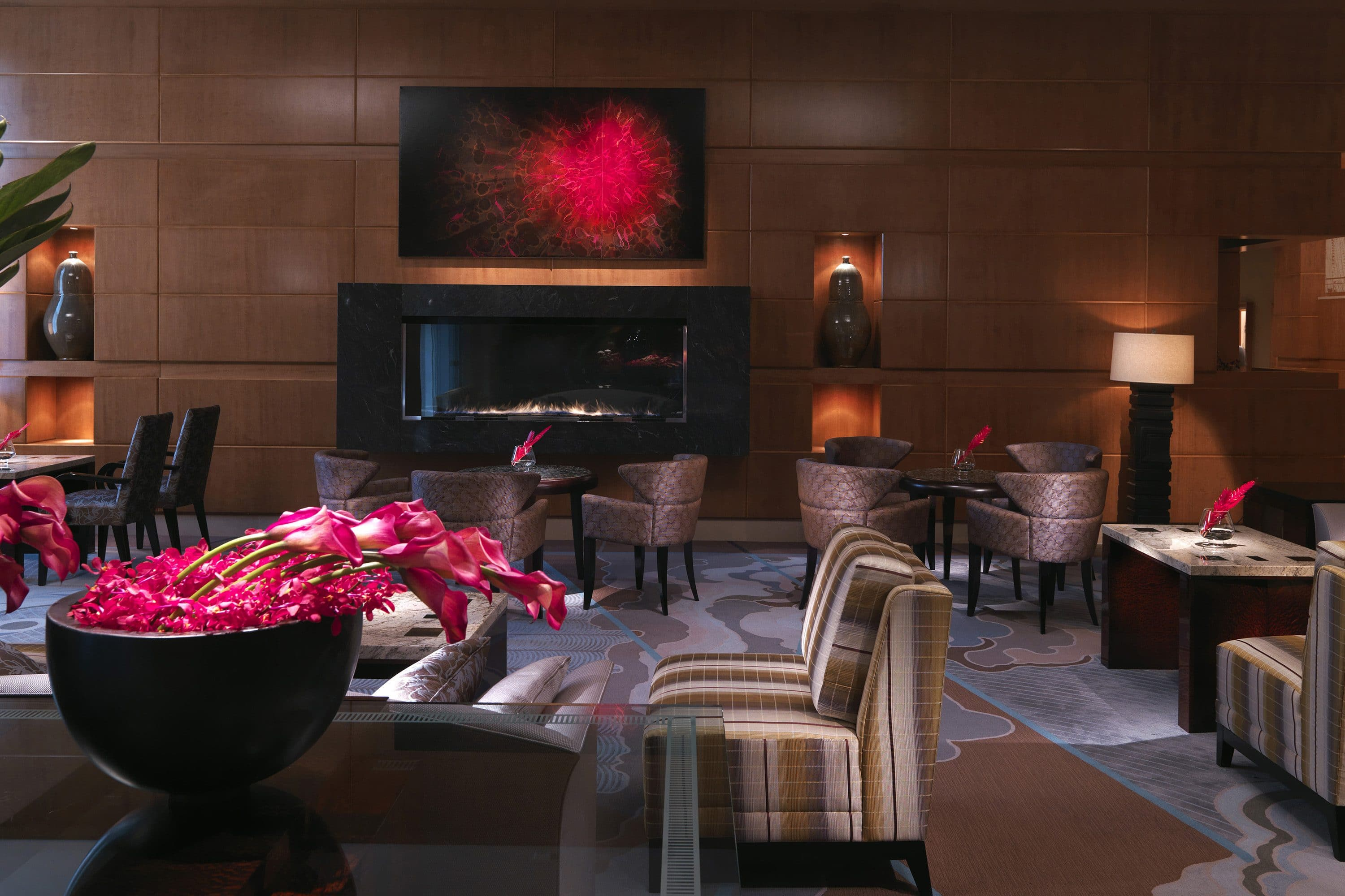 Tables by the fireplace in the Lobby Lounge at Mandarin Oriental, Boston