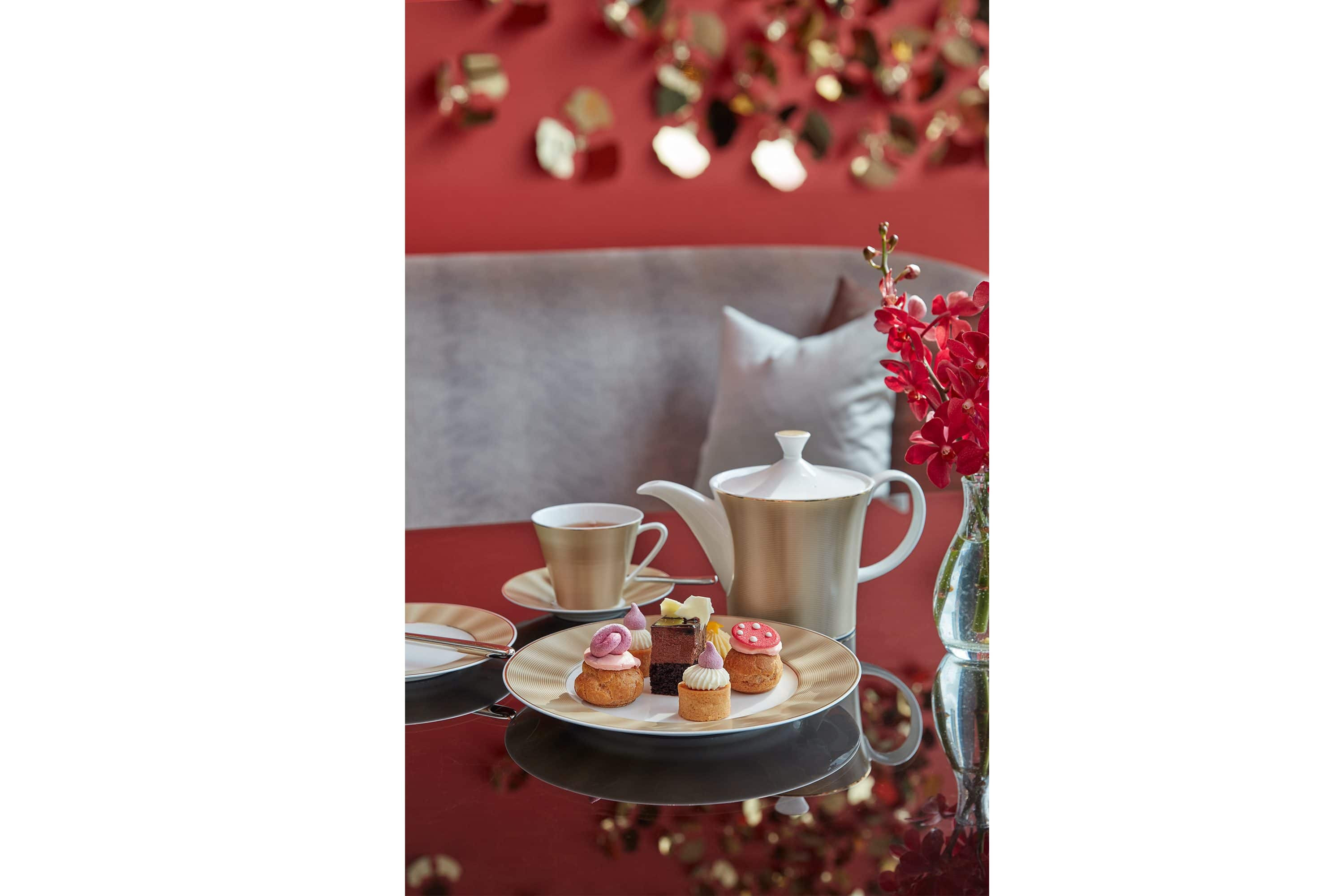 Plate of petit fours and a teapot