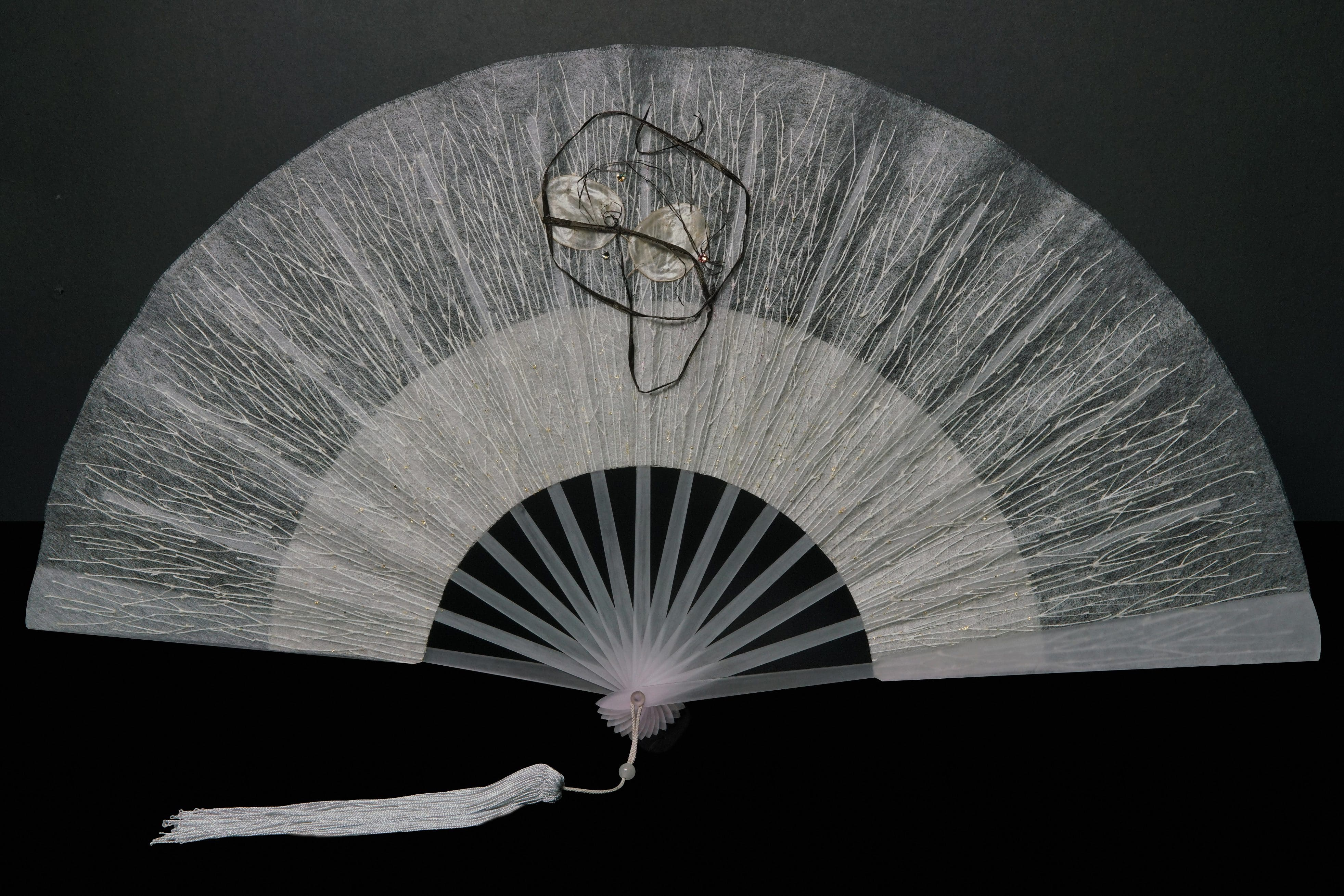 The specially designed silk and paper fan for Mandarin Oriental Wangfujing