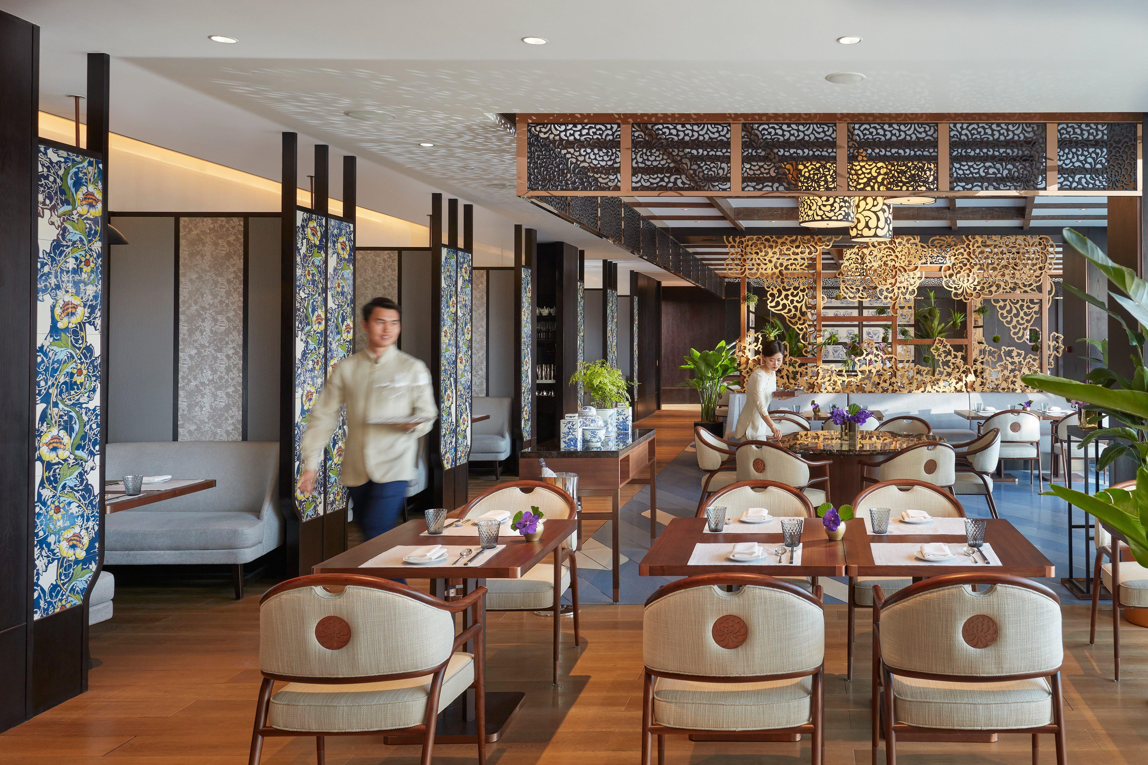 Servers prepare tables at Cafe Zi at MO Wangfujing