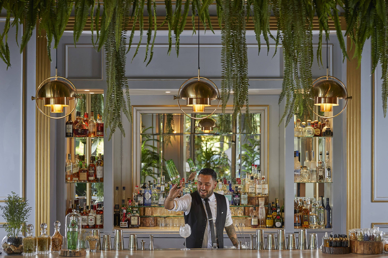 Barman prepares a drink at Bar Origen at Mandarin Oriental, Santiago
