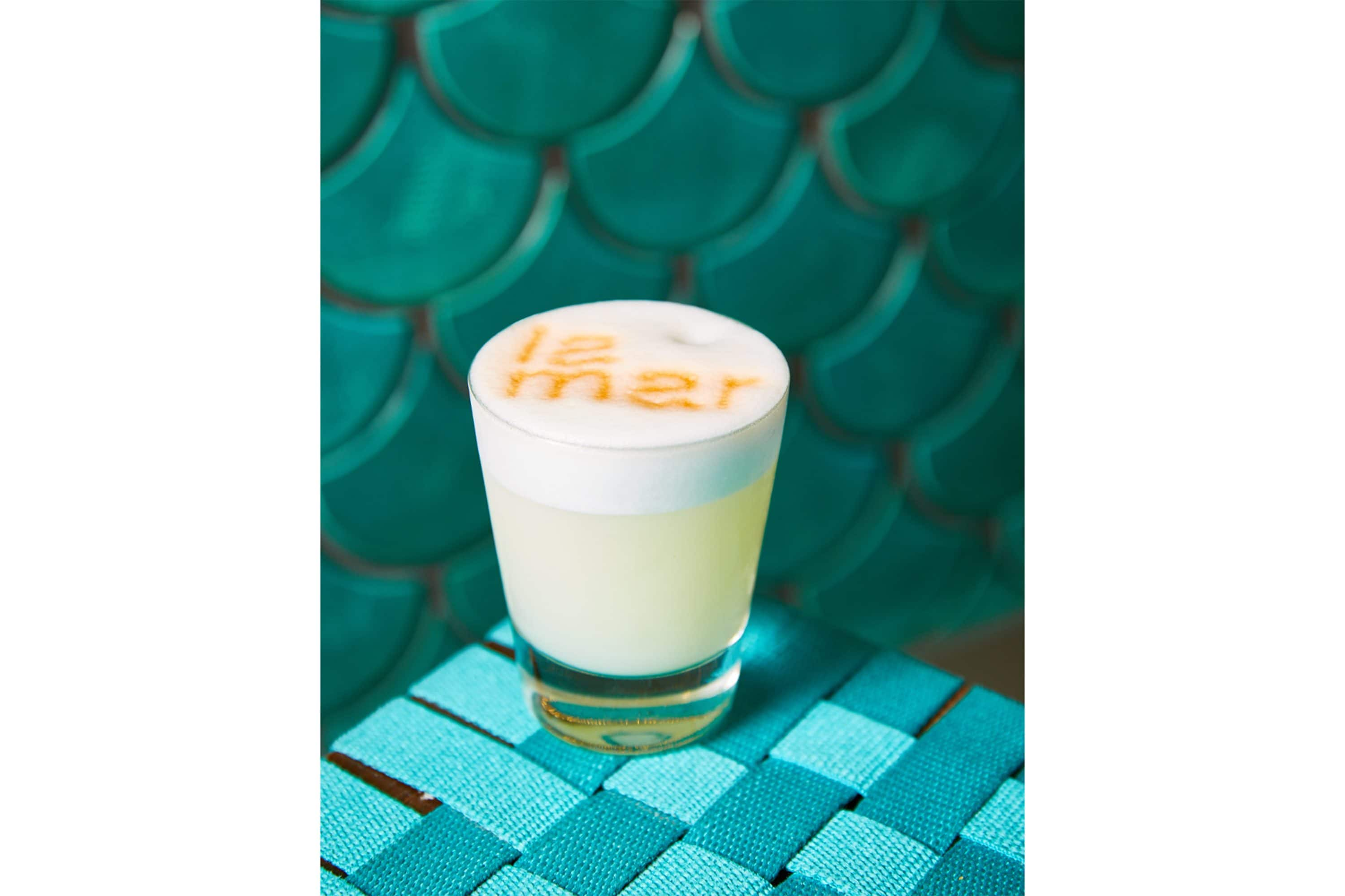 Pisco sour cocktail with La Mar dusted on top