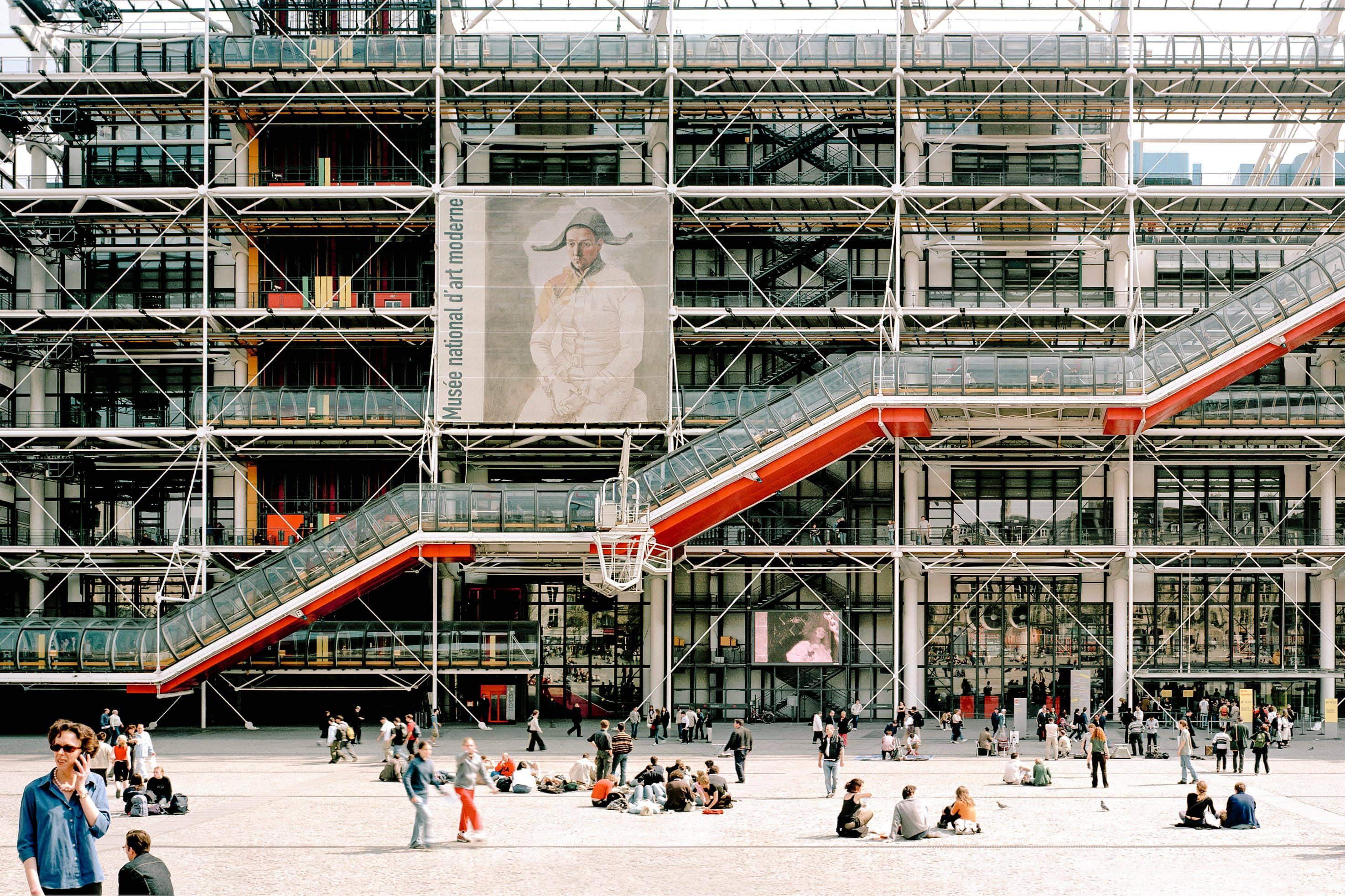 Exterior of the Centre Pompidou with its exposed colourful pipes stairs and supports as seen from Place George Pompidou