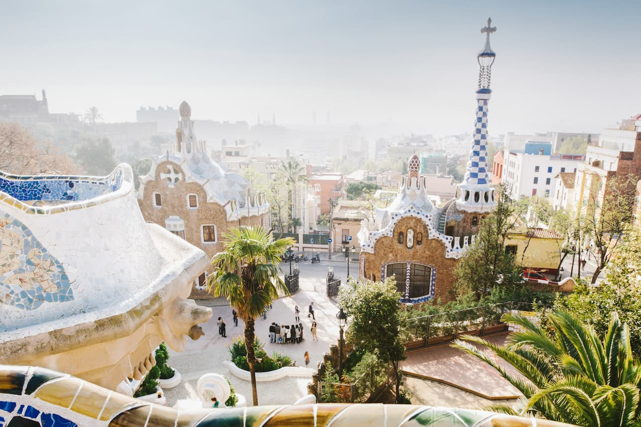 A view of Barcelona from the colourful tiled Park Güell by Gaudí, Spain