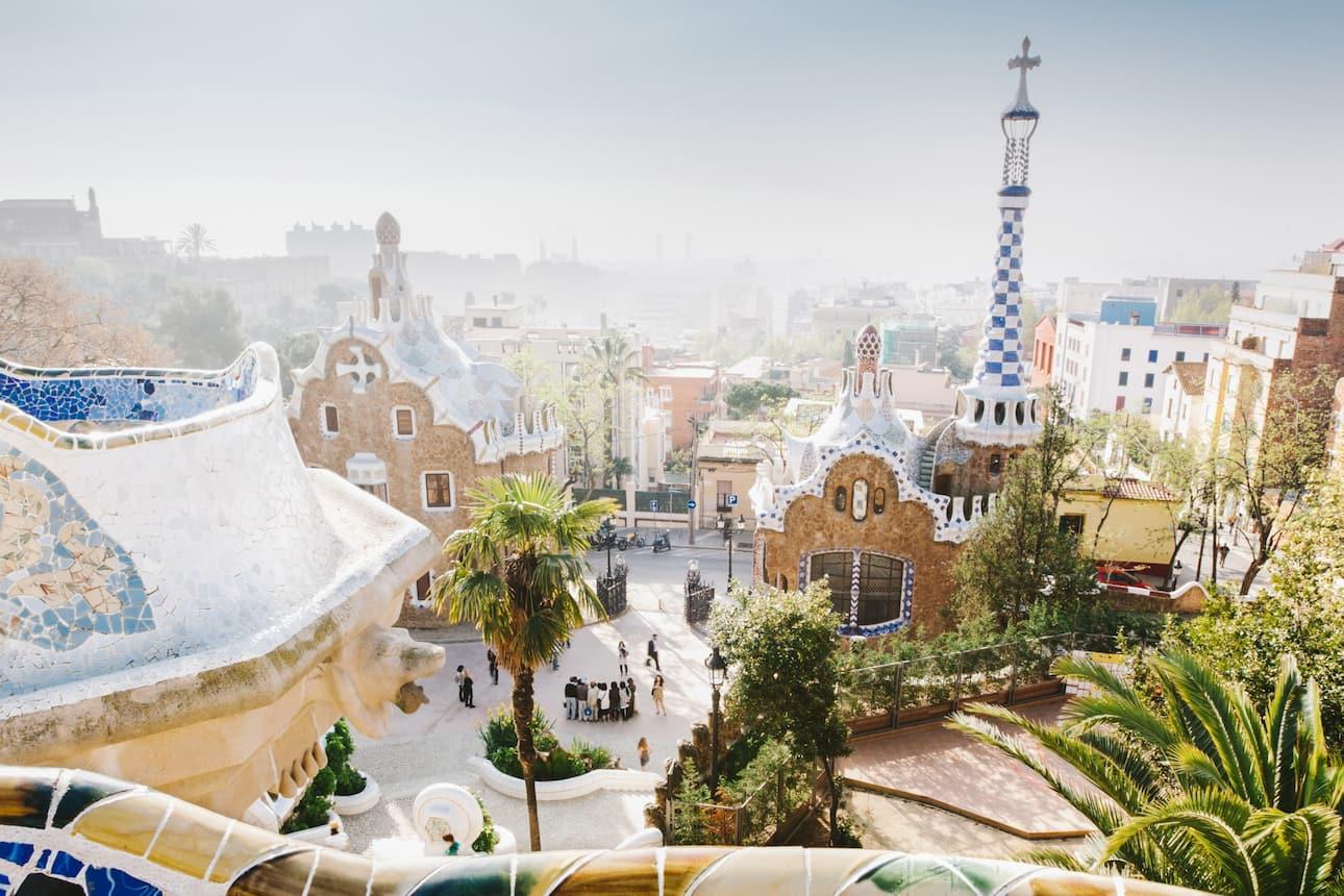 A view of Barcelona from the colourful tiled Park Güell by Gaudí, Spain
