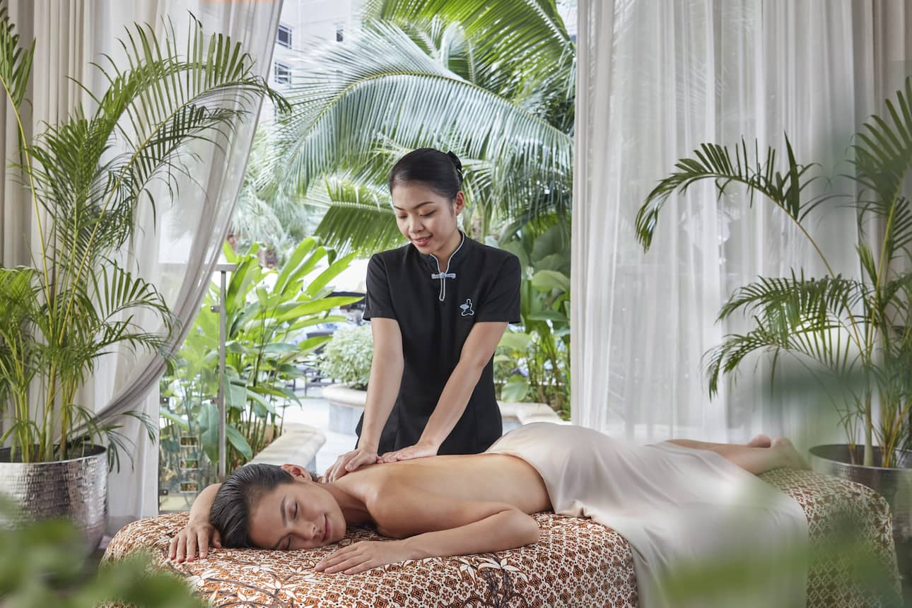 Woman receives massage from therapist