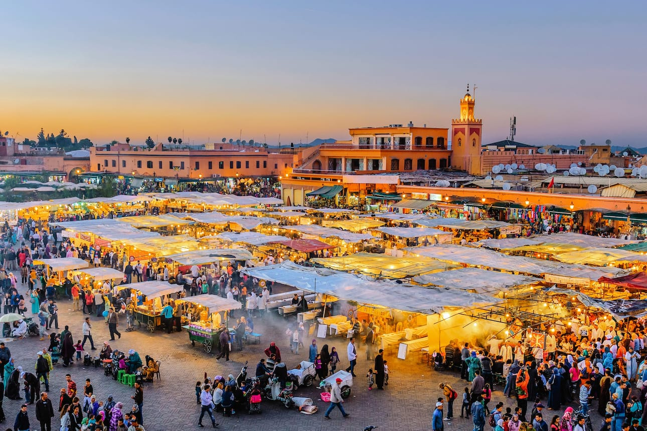 The busy market stalls of the Medina in Marrakech at sunset
