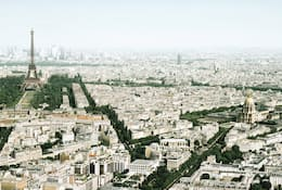 Bird's-eye view of Paris with the imposing Eiffel Tower in the background