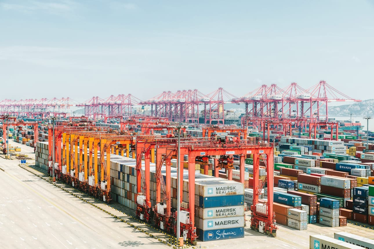 Shipping containers and cranes at port of Shanghai