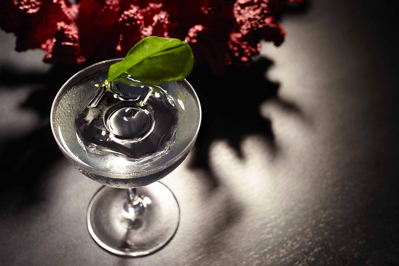 The Elixir cocktail finished with a kaffir lime leaf