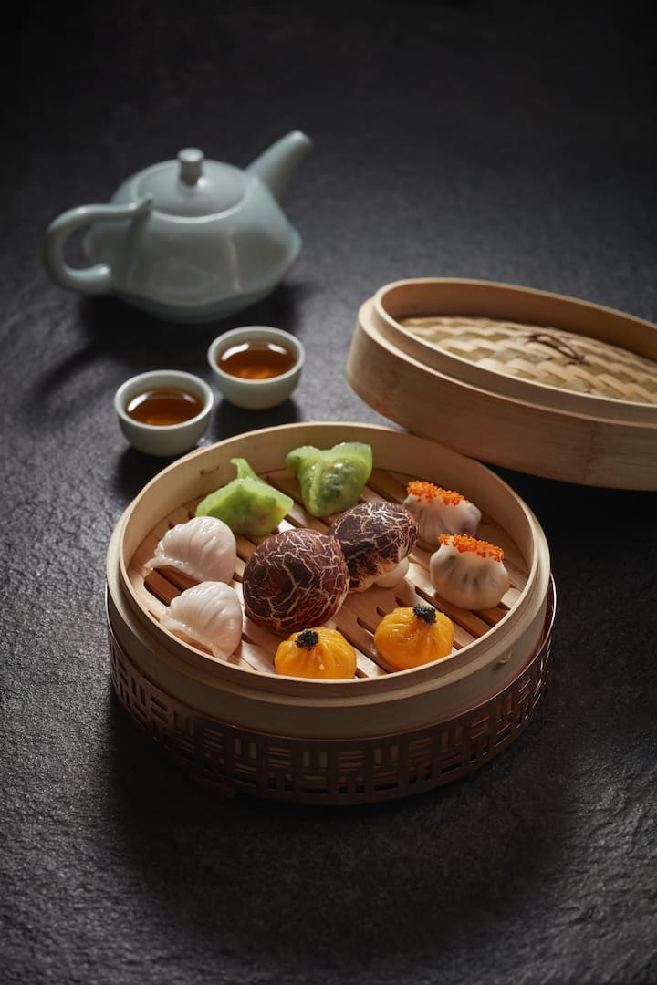dim sum with tea pot served at liang