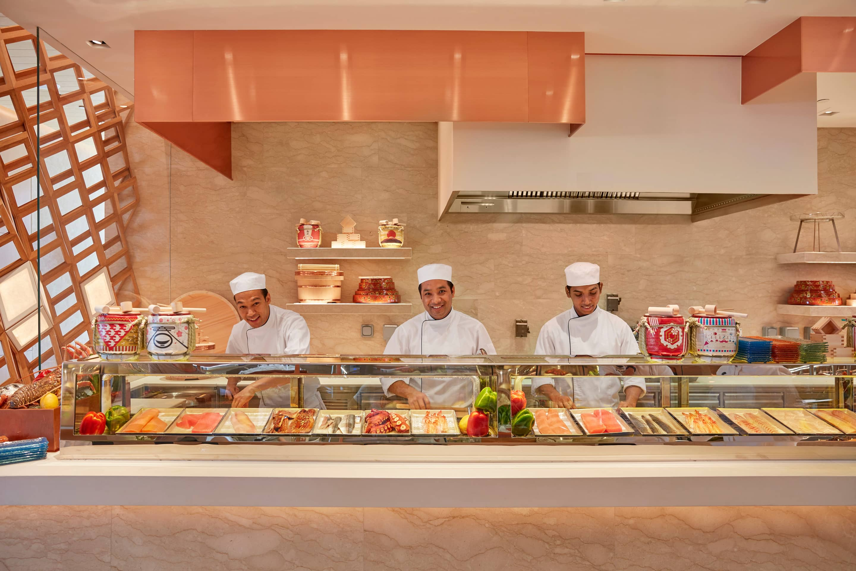 fine dining, cooking station, with chefs smiling