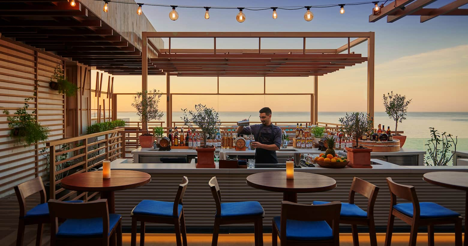 tasca infinity bar with sunset background
