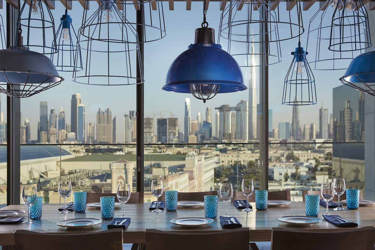 View of the Dubai skyline from a table at Tasca