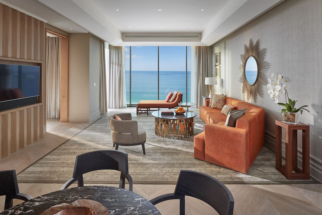 Four Bedroom Sea View Suite living room with dining table