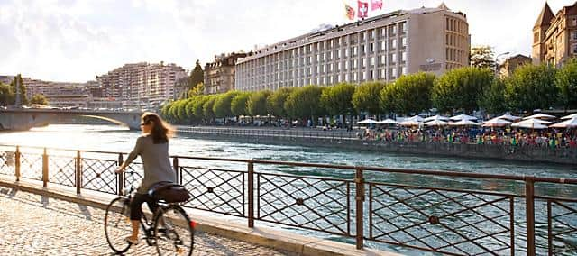 Woman biking along the Rhone River
