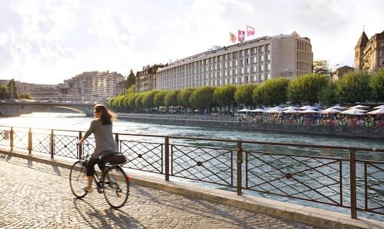 Cyclist rides past Mandarin Oriental, Geneva