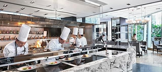 open kitchen in ebony at mandarin oriental, guangzhou