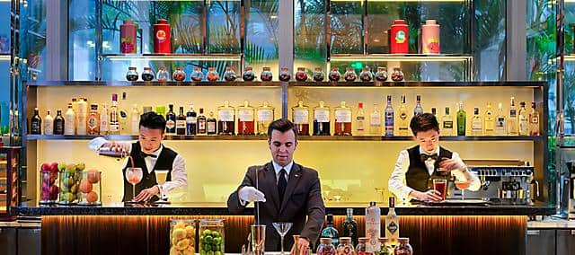 bar team preparing cocktails in jin bar at mandarin oriental, guangzhou