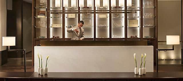 at mandarin oriental, guangzhou, taikoo lounge server preparing tea