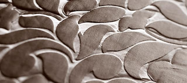 gray leaf shape embroidery decoration on textile
