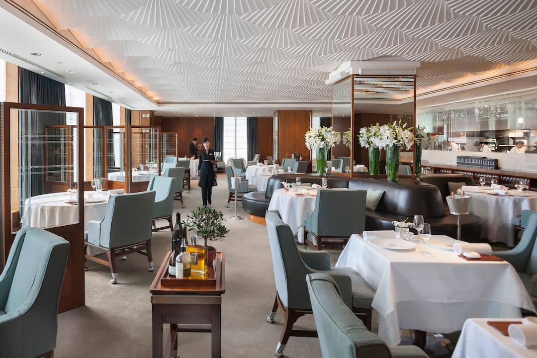dining area of mandarin bar and grill at mandarin oriental, hong kong